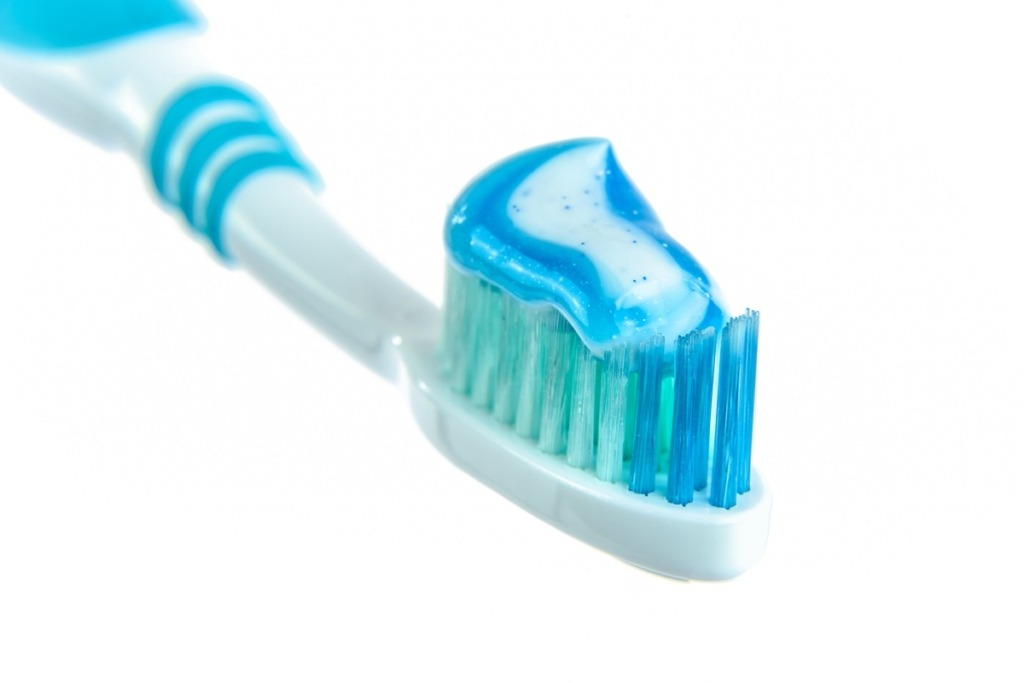 white toothbrush with blue toothpaste