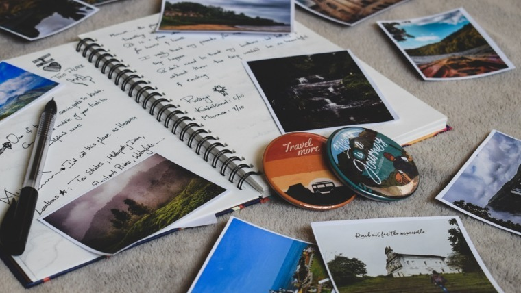 notebook and photos on floor