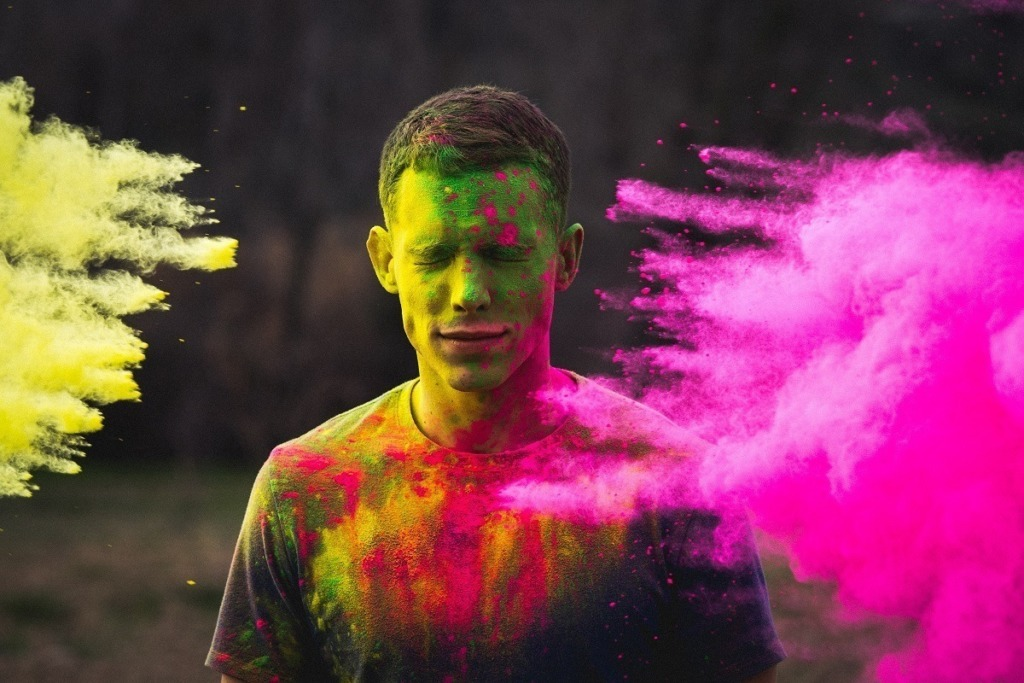man dusted with coloured powder