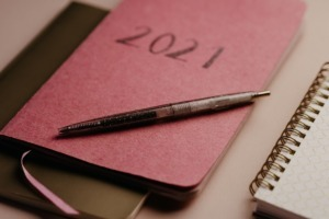 closed 2021 diary with pen ontop