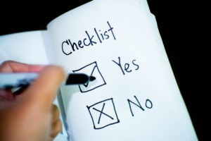 marking yes no checklist with felt marker